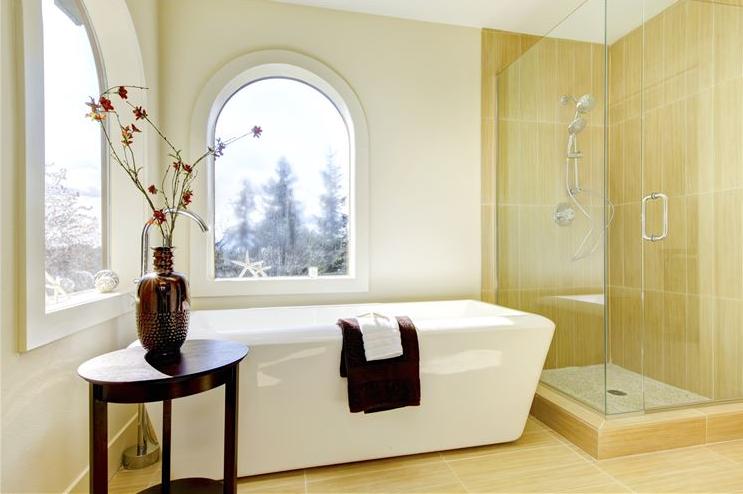 Bathroom with flexible moulding around window.