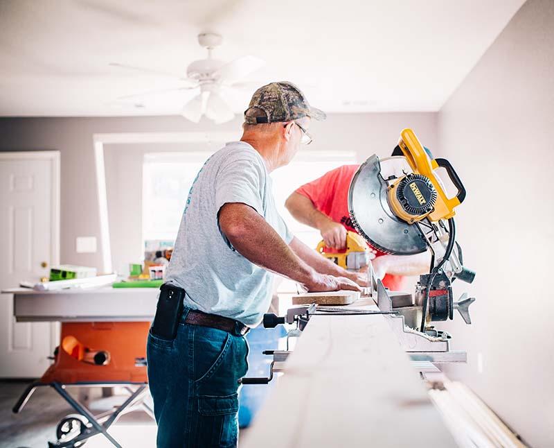 man cutting moulding