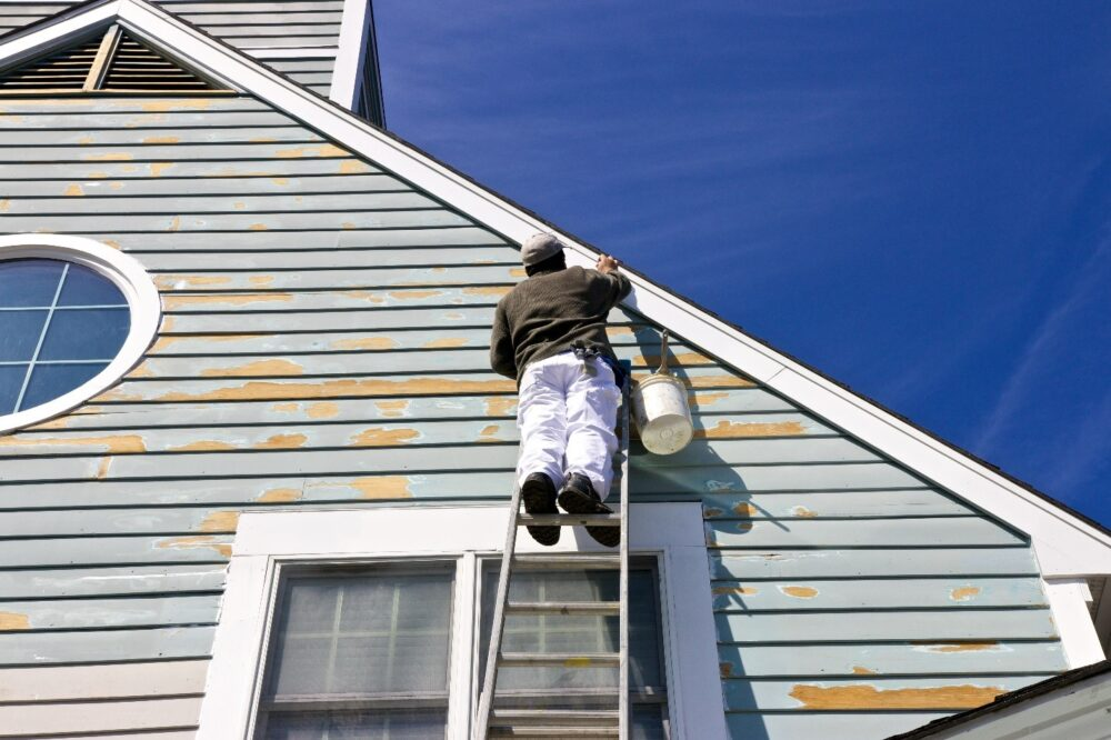 Man working on exterior siding